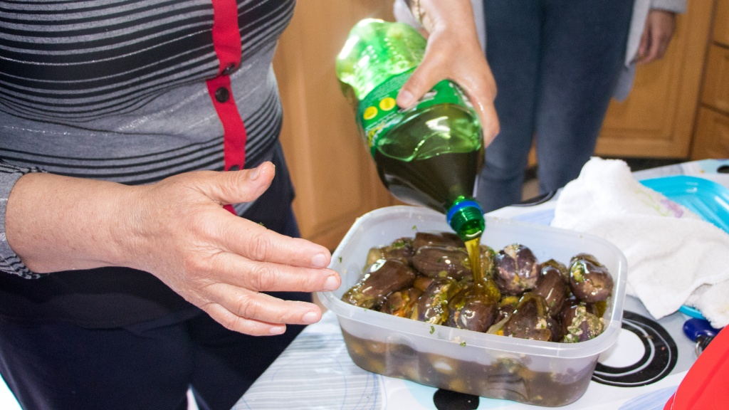 The final stage, pouring olive oil over the makdous - by Stephanie Saldaña