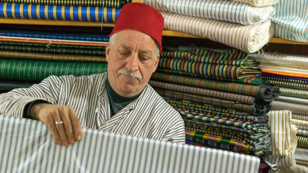 Bilal Abu Khalaf in his fabric shop - by Aaron Cederberg